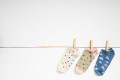 Socks hanging with clipping path. Royalty Free Stock Images