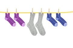 Socks hanging isolated on white Royalty Free Stock Image