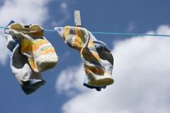 Socks hanging on the rope Royalty Free Stock Photo