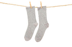 Socks hanging on a rope clothesline Stock Photo
