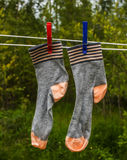 Socks hanging on the rope for drying clothes. On clothespins Royalty Free Stock Images