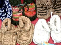 Socks. Knitted baby socks on the market in Tbilisi royalty free stock photography