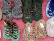 Socks. Knitted baby socks on the market in Tbilisi stock photography