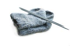 Socks and knitting needle. Woolen socks and knitting spokes Royalty Free Stock Photography