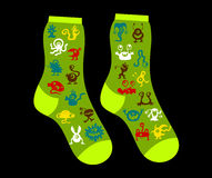 Socks with monsters on black background Royalty Free Stock Image