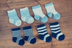 Socks for newborn baby boy, extending family and expecting for kids. Socks for newborn baby boy, concept of expecting for kids and extending family royalty free stock photography