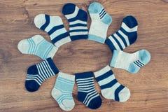 Socks for newborn baby boy, extending family and expecting for kids. Vintage photo. Socks for newborn baby boy, concept of expecting for kids and extending stock images