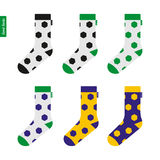 Socks with Soccer Ball Pattern in Brazil Flag Colors Stock Images