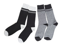 Socks. Two pairs of dark coloured socks laid over a white background Royalty Free Stock Image