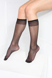 Socks, Women's socks. Beautiful, leggy woman in thin tights and fashionable styling Stock Photography