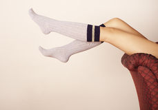 Socks. Young woman wearing knee-length socks Royalty Free Stock Photos