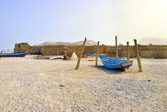 Socotra, Yemen. Blue fishing boat on the ocean shore at Socotra island, Yemen. Warm evening light Royalty Free Stock Images