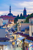 Socratous Street Rhodes. Socratous Street with the Mosque of Suleyman at night Rhodes Greece stock image