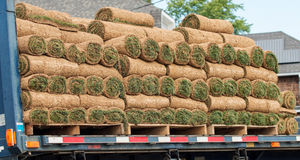 Sod being delivered on a truck royalty free stock image