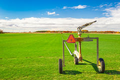 Sod Farm. And sprinkler irrigation equipment on a sunny day with blue sky stock photos