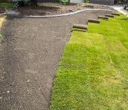 Sod installation in progress. Front lawn sod rolls installation royalty free stock photo