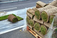 Sod rolls ready to be laid on the road royalty free stock images