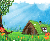 Sod roof house. Fantasy house with a sod roof on a meadow with blooming tulips Stock Photography