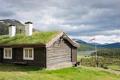 Sod roof log cabin stock image