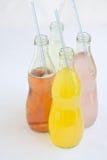 Soda assorted flavors and colors. Italian sodas with various flavors including orange, lemon, berry, pink lemonade. Assorted Fruit Flavored Sodas, orange, lemon Royalty Free Stock Photo