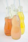 Soda assorted flavors and colors. Italian sodas with various flavors including orange, lemon, berry, pink lemonade. Assorted Fruit Flavored Sodas, orange, lemon Royalty Free Stock Photography