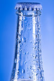 Soda bottle with cap. And water drops Royalty Free Stock Images