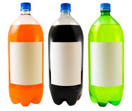 Soda Bottles. A close up on three soda bottles isolated on a white background Stock Photography