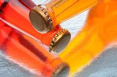 Soda Bottles on Reflective Surface Stock Photo