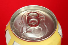 Soda Can. Top of a yellow soda can on a red background Royalty Free Stock Images