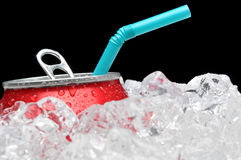 Soda Can in Ice with Straw Royalty Free Stock Image