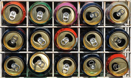 Soda can recycling rack. A rack holding empty soda cans forming an abstract pattern Royalty Free Stock Photos