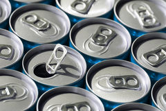 Soda cans. Blue soda cans, top view, with one opened royalty free stock photography