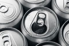 Soda cans with one opened Stock Photos