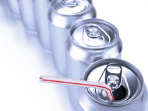 Soda cans and straw Royalty Free Stock Photos
