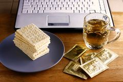 Soda Crackers, cup of tea and a computer Stock Image