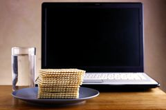 Soda Crackers, Glass of water and a computer Stock Photos