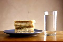 Soda Crackers and Glass of water Stock Image