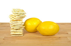Soda crackers and lemons Stock Images