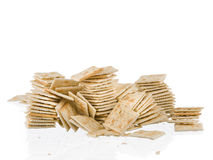 Soda crackers stacks fallen mess  on white Royalty Free Stock Image