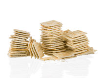 Soda crackers stacks half eaten isolated on white background Stock Images
