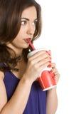 Soda de consumición de la muchacha Foto de archivo