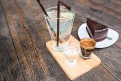 Soda del caffè espresso con il dolce di cioccolato Fotografie Stock