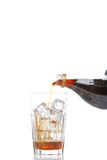 Soda derramada em um vidro Fotos de Stock
