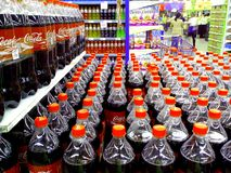 Soda drink plastic bottles inside a grocery store Royalty Free Stock Images