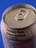 Soda Facts. A soft drink can displaying nutrional facts. Shallow depth of field stock images