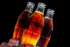 Soda glass bottles  isolated on a black Stock Image