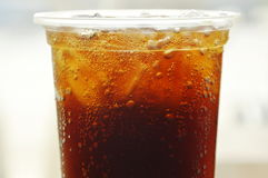 Soda with ice in plastic cup. Soda with ice in clear plastic cup stock images