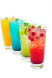 Soda  juice. Four cups of soda juice in the white background Stock Photo