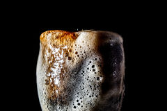 Soda large glass, overflowing glass of soda closeup with bubbles isolated on black Royalty Free Stock Photos