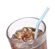 Soda no vidro com palha imagem de stock
